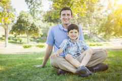 Handsome Mixed Race Father and Son Park Portrait Stock Images