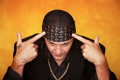 Handsome Mixed Race Man Pointing at his Head Stock Photos