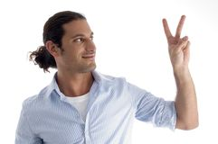 Handsome model gesturing victory Stock Photos