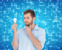 Handsome model holding a bulb Stock Photography