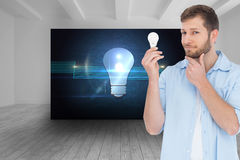 Handsome model holding a bulb Royalty Free Stock Image