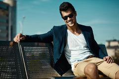 Handsome model man in casual suit in sunglasses Stock Image