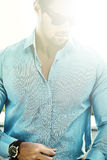 Handsome model man in casual suit in sunglasses Stock Images