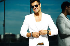 Handsome model man in casual suit in sunglasses Royalty Free Stock Images