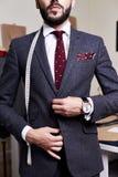 Handsome Model Wearing Bespoke Suit. Mid section portrait of handsome bearded gentleman wearing fashionable suit and jacket posing in atelier studio Stock Image