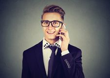 Handsome young modern businessman calling on mobile phone royalty free stock images