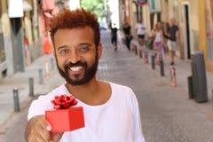 Handsome modern man holding a present stock photos