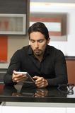 Handsome modern young man using tablet Stock Photo