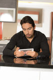 Handsome modern young man using tablet Royalty Free Stock Images