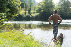 Handsome Mucular Man Flexing Muscles Outdoors In Nature Stock Photography