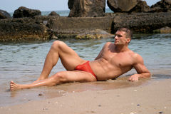 A handsome, muscle man. Muscle man posing at the sea Royalty Free Stock Image