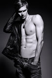 Handsome muscled fit male model man in leather jacket Stock Image