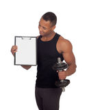 Handsome muscled man training with dumbbells and clipboard in bl Stock Photos