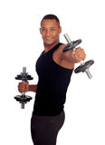 Handsome muscled man training with dumbbells Stock Images