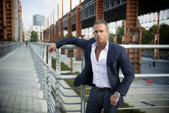 Handsome muscular blond man standing in city environment. Handsome muscular blond man standing in city setting or former industrial environment Royalty Free Stock Images
