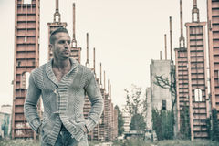 Handsome muscular blond man standing in city setting Royalty Free Stock Images
