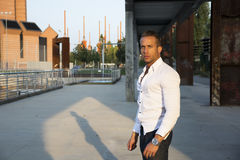 Handsome muscular blond man standing in city setting Royalty Free Stock Photos