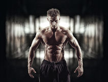 Handsome muscular bodybuilder in dressing room Stock Images