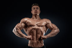 Handsome muscular bodybuilder posing on Front Lat Spread Royalty Free Stock Photography