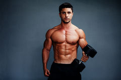 Handsome Muscular Bodybuilder Posing Stock Photography