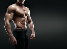 Handsome muscular bodybuilder. Posing over black background.  with clipping path Stock Photos