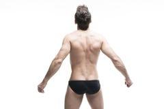 Handsome muscular bodybuilder posing on white background. Isolated studio shot Stock Photos