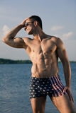 Handsome muscular guy Stock Photos