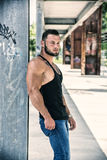 Handsome Muscular Hunk Man Outdoor in City Setting. Showing Healthy Body While Looking Away Royalty Free Stock Image