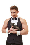 Handsome muscular male dancer posing with kitten Stock Images
