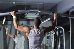 Handsome Muscular Male Model With Perfect Body Doing Pull Ups Stock Image