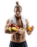 Handsome muscular male shirtless and with towel on shoulders holding fresh fruits and orange juice posing on white background. Resting time. Handsome muscular Royalty Free Stock Image