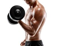Handsome muscular man with bare chest lifting dumbbell, studio shot on white background Stock Photos