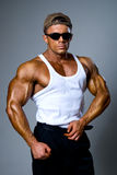 Handsome muscular man in dark glasses Royalty Free Stock Photography