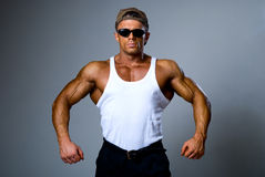 Handsome muscular man in dark glasses and a white shirt Royalty Free Stock Images