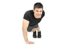 Handsome muscular man doing push ups Stock Photo