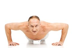 Handsome muscular man doing push-ups. Stock Image