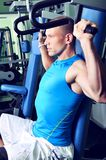 Handsome muscular man exercising in a gym Royalty Free Stock Photo