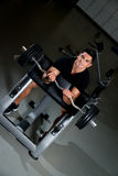 Handsome muscular man exercising in Gym Royalty Free Stock Photos