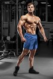 Handsome muscular man in gym, strong male naked torso abs Royalty Free Stock Photography