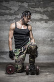 Handsome muscular man on his garage Royalty Free Stock Photography