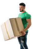 Handsome muscular man holding big cardboard box Royalty Free Stock Photography