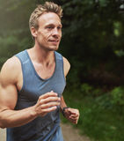 Handsome Muscular Man Jogging at the Park Stock Photos