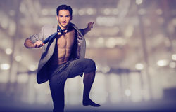 Handsome muscular man in loose suit Royalty Free Stock Photography