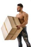 Handsome muscular man shirtless holding big cardboard box Stock Images