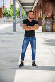 Handsome muscular man standing in city setting Royalty Free Stock Photo