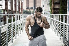 Handsome muscular man standing outdoor in city Royalty Free Stock Photography