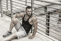 Handsome muscular man standing outdoor in city Royalty Free Stock Images
