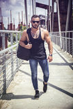 Handsome muscular man standing outdoor in city Royalty Free Stock Photos