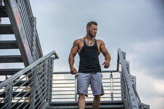 Handsome muscular man standing outdoor in city Stock Photo