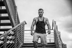 Handsome muscular man standing outdoor in city Stock Image